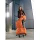 Oranžová cestovná batožina